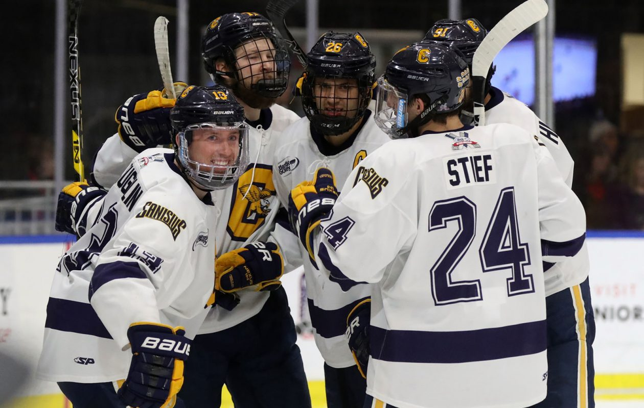 Canisius Golden Griffins forward Dylan McLaughlin, left, celebrates a goal in the first period at HarborCenter in Buffalo on Dec. 9. (James P. McCoy/Buffalo News)