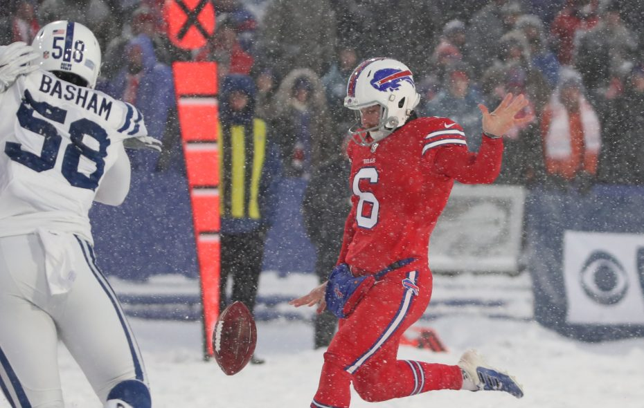 Bills punter Colton Schmidt dealt with the weather conditions during the snowy win over the Colts. (James P. McCoy/News file photo)