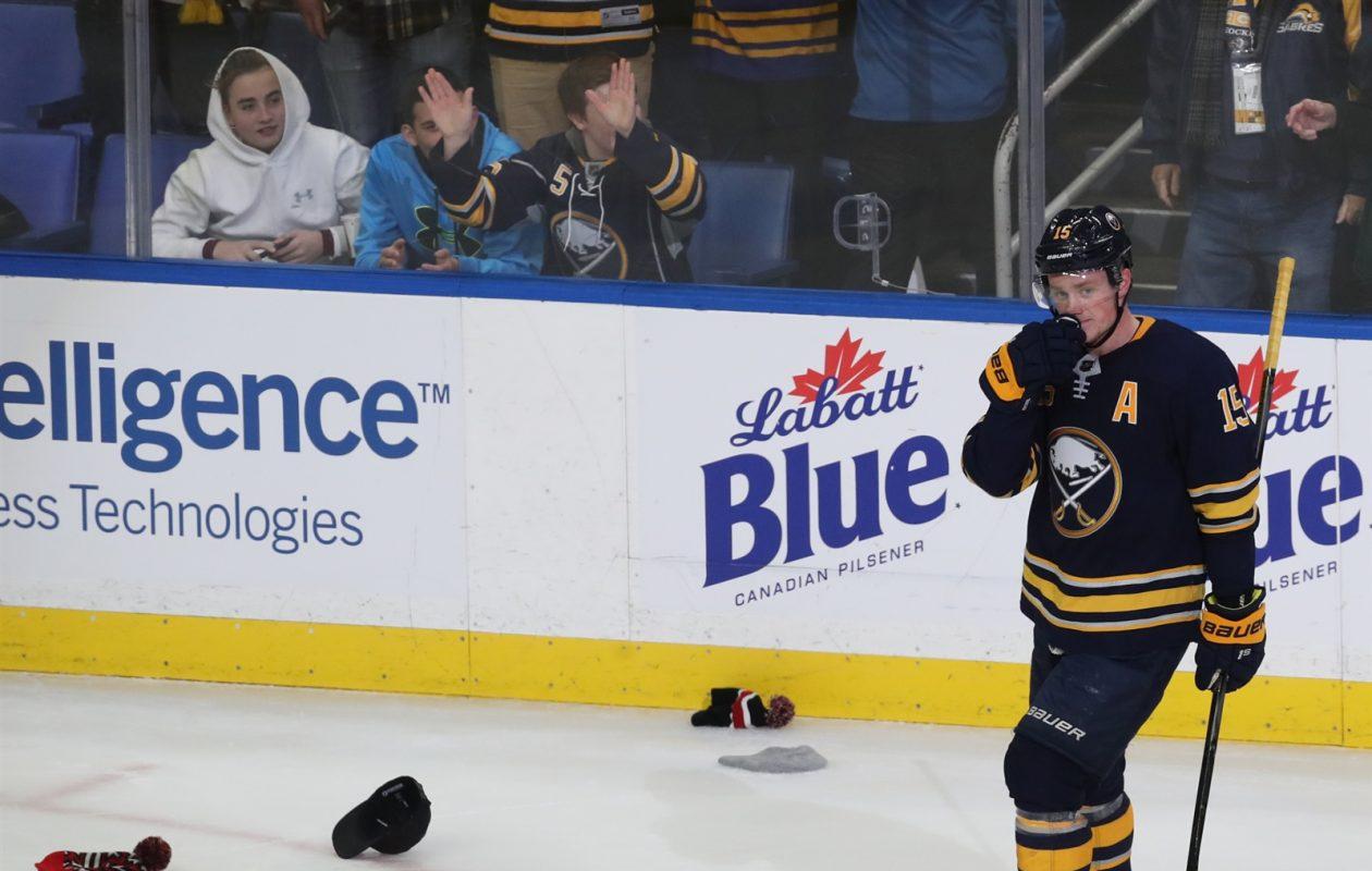 Hats rained onto the ice to celebrate Jack Eichel's three-goal night Friday. (James P. McCoy/Buffalo News)