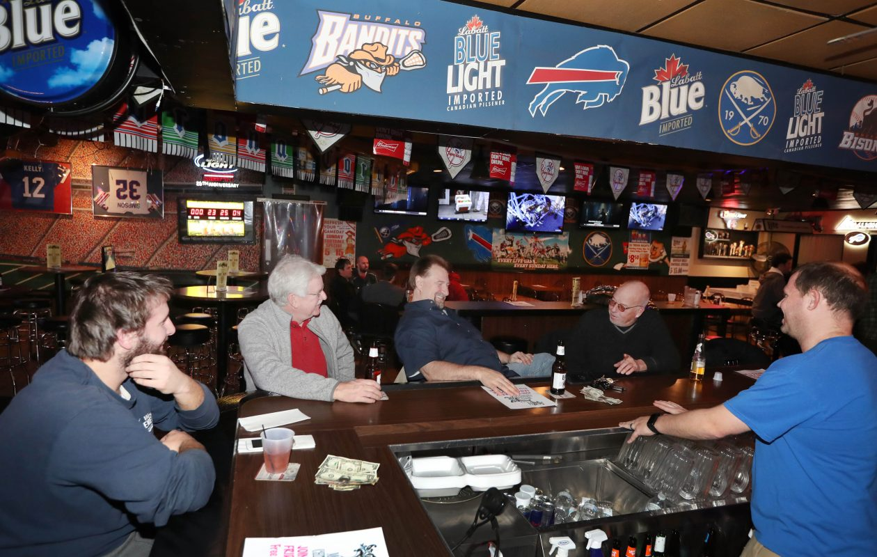 Patrons hang out at the IV Stallions. (Sharon Cantillon/Buffalo News)