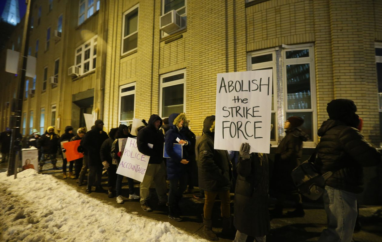 Residents concerned about racial justice and police brutality rally in support of Wardel 'Meech' Davis at Buffalo Police Headquarters on Monday, Dec. 13, 2017.    (Mark Mulville/Buffalo News)