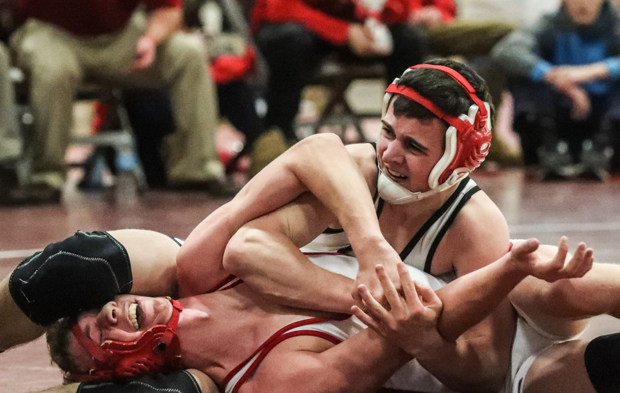 Clarence's Anthony Corigliano beat Brandon Swaciak of Iroquois by a 19-3 technical fall during the ECIC Championships on Saturday. The Red Devils finished third as a team behind Lancaster and Iroquois. (James P. McCoy/Buffalo News)