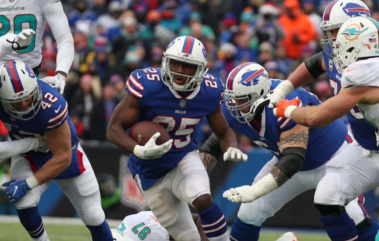 Buffalo Bills running back LeSean McCoy shoots a gap in the Miami defense. (James P. McCoy/News file photo)