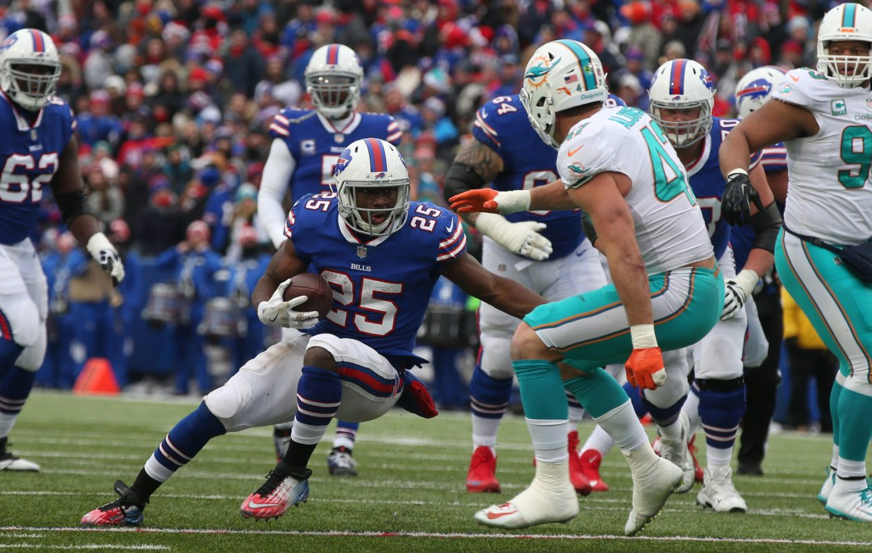 LeSean McCoy gets past  Dolphins linebacker Kiko Alonso for a first down last season at New Era Field. (James P. McCoy/News file photo)
