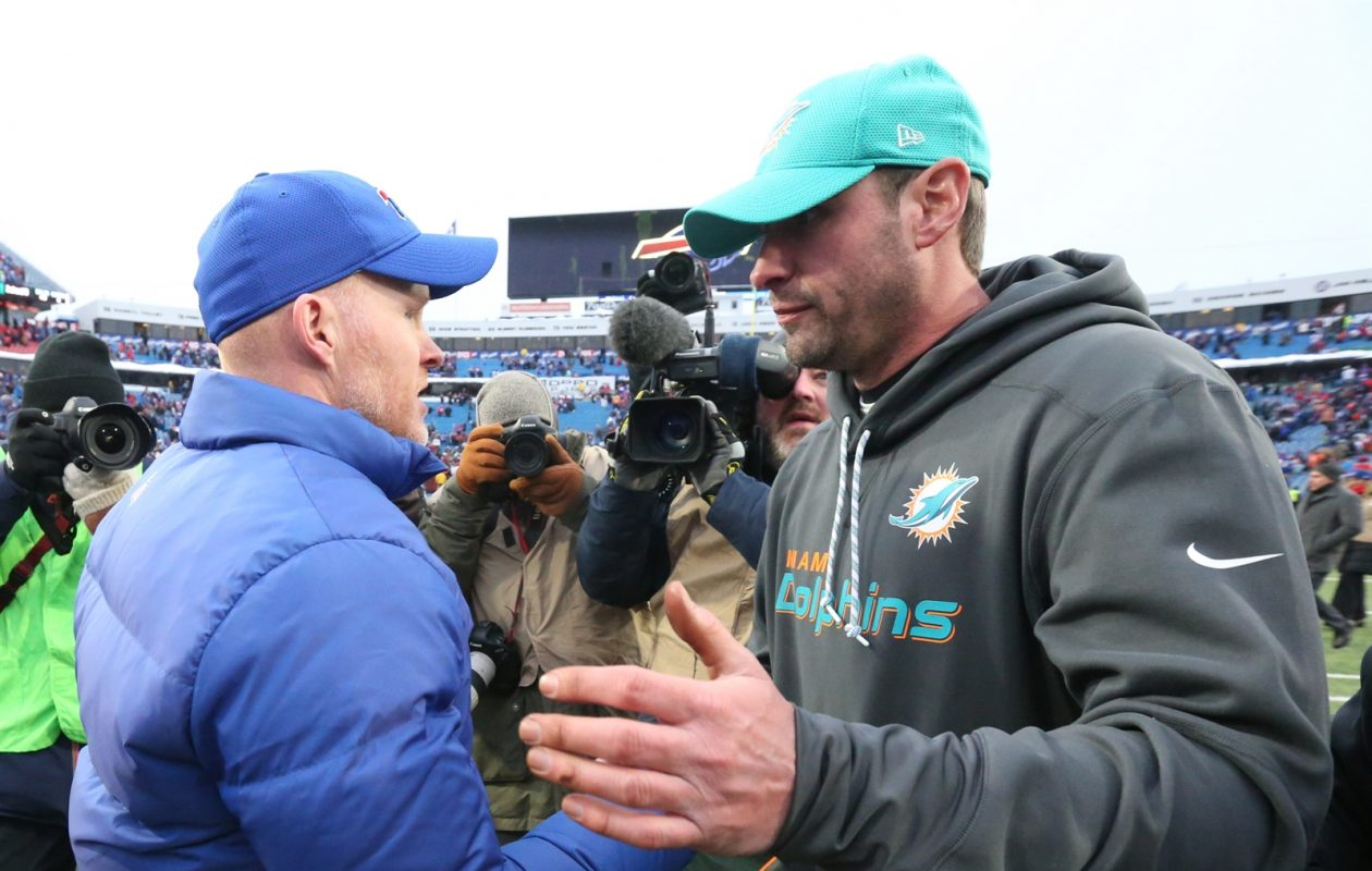 Sean McDermott and Dolphins coach Adam Gase meet after the game. (James P. McCoy/Buffalo News)