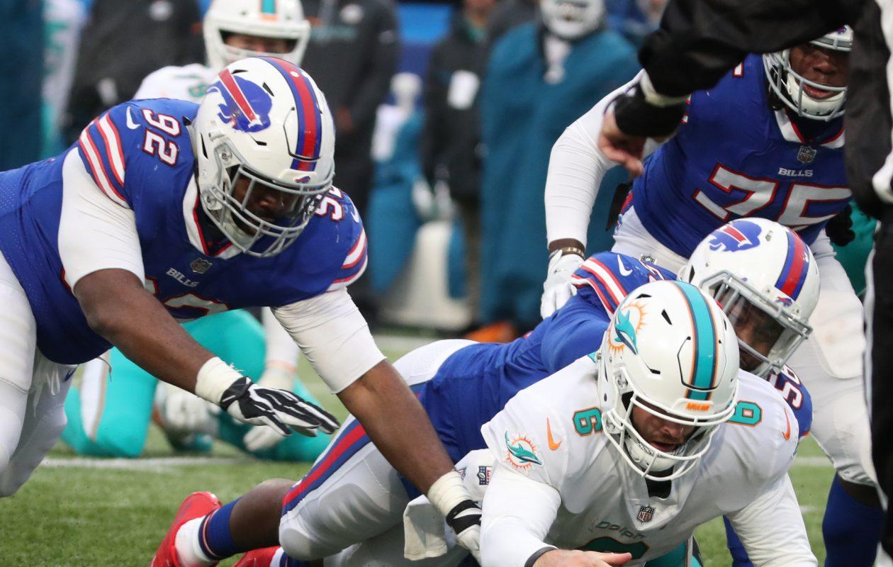 Bills defensive end Ryan Davis (56) had six tackles Sunday against Miami. (James P. McCoy/Buffalo News)