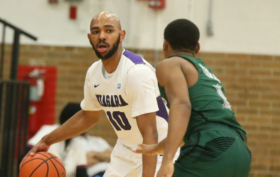 Niagara Purple Eagles guard Kahlil Dukes (10) brings the ball up the court against Cleveland State Vikings guard Kasheem Thomas (1) in the first half at Niagara University's Gallagher Center in Lewiston N.Y. on Tuesday, Dec. 19, 2017.  (James P. McCoy / Buffalo News)