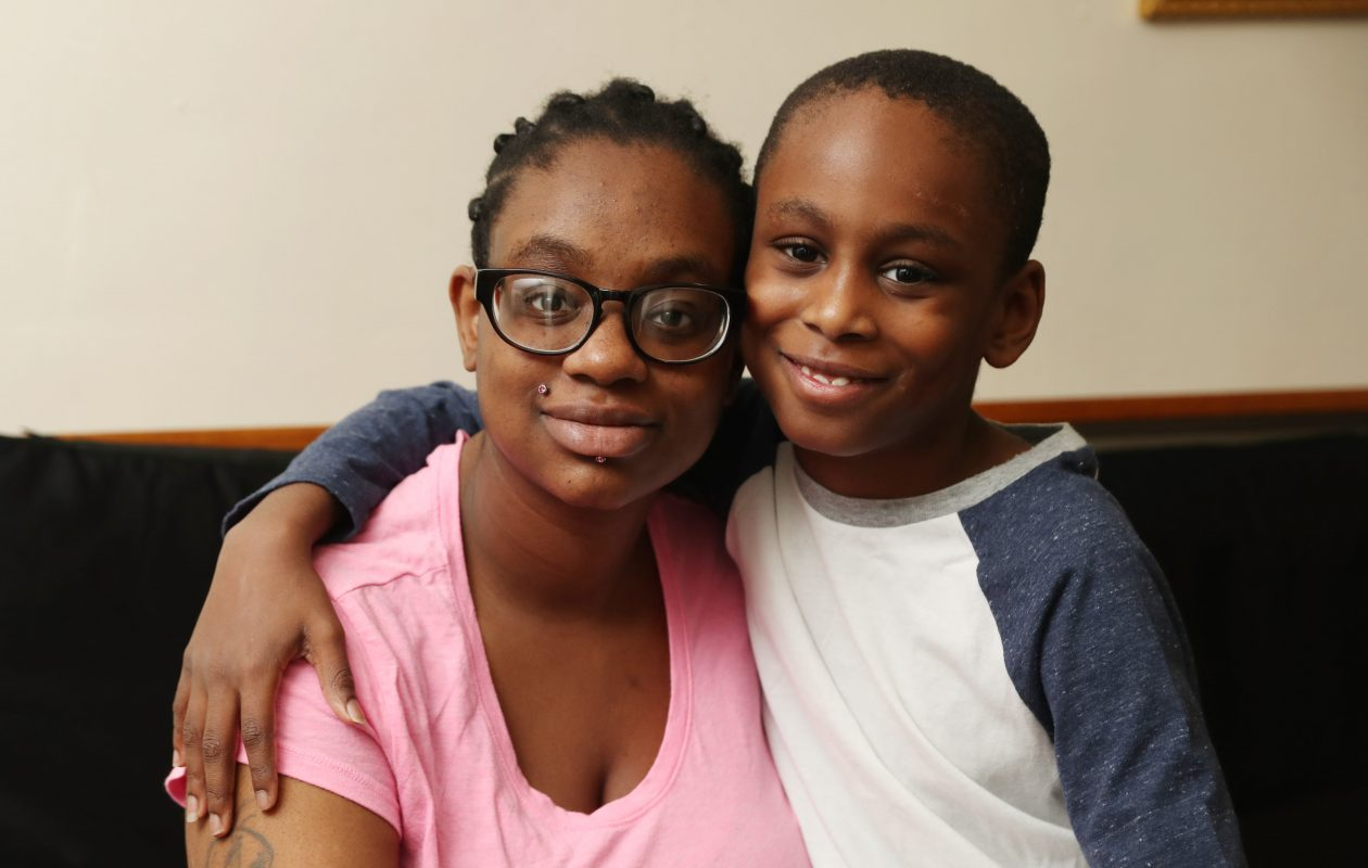 Tremont Seals, 8, with his mother, Tameka Jones, at their home in Buffalo. It's been five months since Tremont survived a hit-and-run that left him with a traumatic brain injury.  (Sharon Cantillon/Buffalo News)