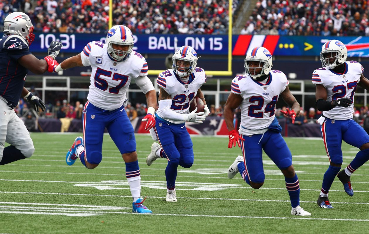 Buffalo Bills free safety Jordan Poyer (21) heads for the end zone after intercepting Tom Brady in Sunday's Bills Patriots game. (James P. McCoy / Buffalo News)