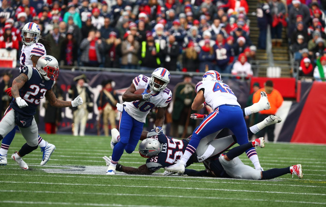 Buffalo Bills wide receiver Deonte Thompson (10) rush for a first down over New England Patriots defensive end Eric Lee (55) in the firrs quarter at Gillette Stadium in Foxborough,on Sunday, Dec. 24, 2017.  (James P. McCoy / Buffalo News)
