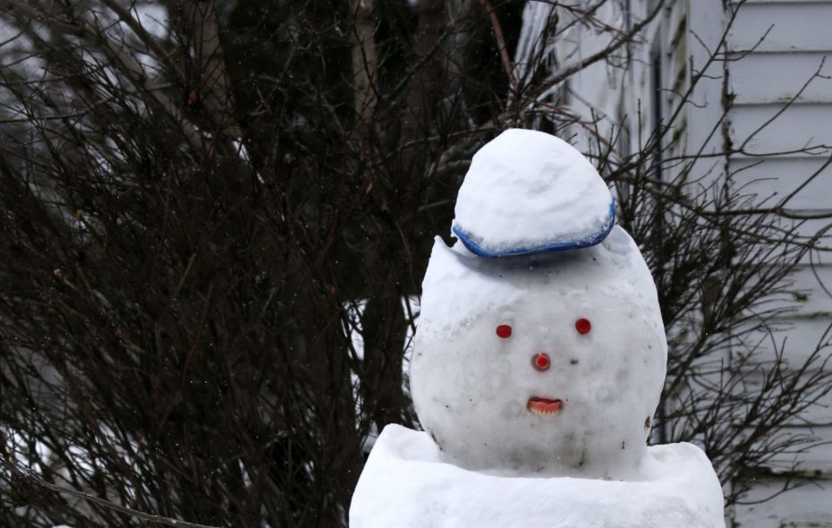 A snowman sits on the lawn on Olean Rd. in the Village of East Aurora on Tuesday, Dec. 26, 2017.  (Robert Kirkham/Buffalo News)