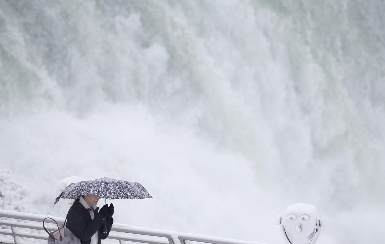 Tourists come from far and wide to see the winter beauty of Niagara Falls.  (Sharon Cantillon/Buffalo News)
