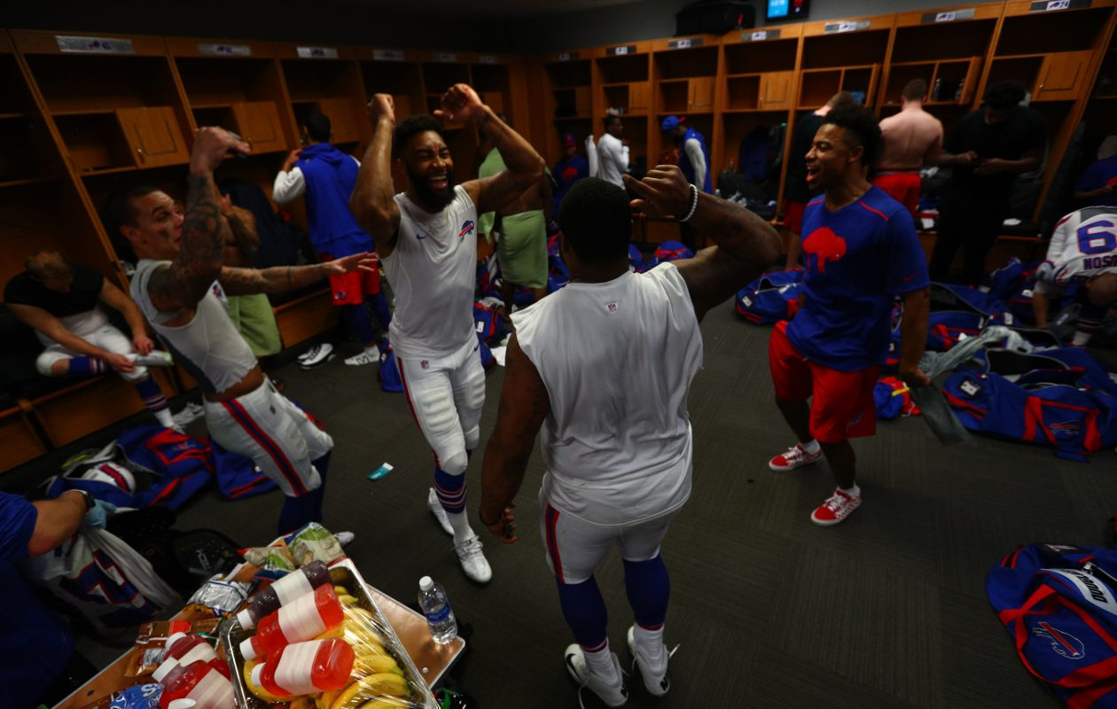 Buffalo Bills celebrate in the locker room after making the playoff for the first time in 17 years. (James P. McCoy / Buffalo News)
