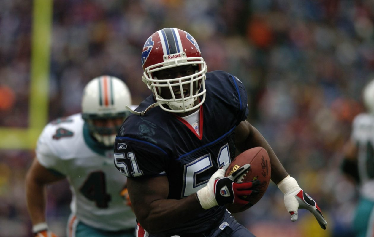 Takeo Spikes (51) returns an interception for a TD  in first-half action against the  Miami Dolphins at Ralph Wilson Stadium in Orchard Park on Sunday Oct. 17 , 2004. (John Hickey/Buffalo News file photo)