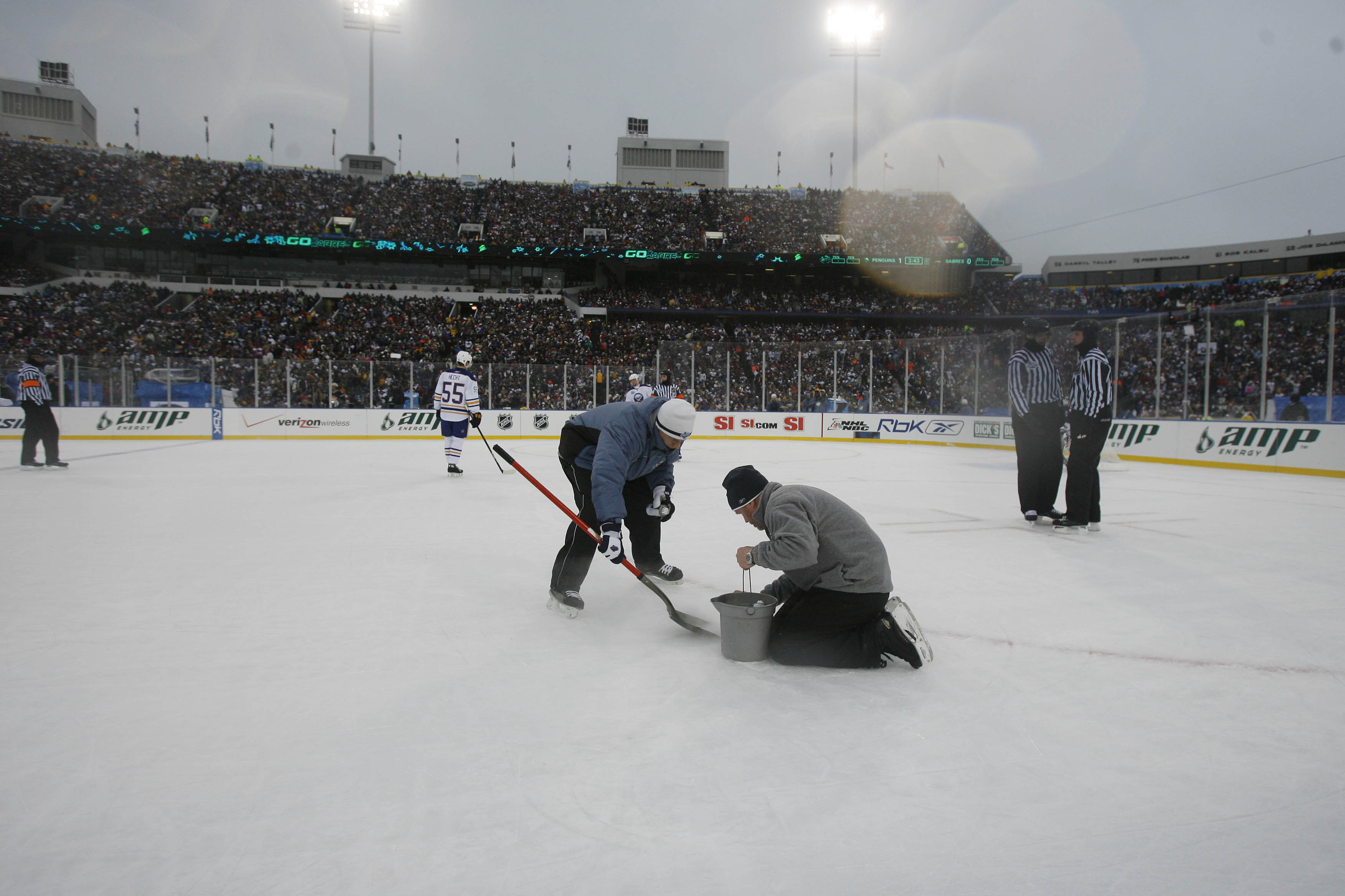 Play is stopped for ice repairs during the first period of the inaugural Winter  Classic (Mark Mulville Buffalo News) c64ba0568