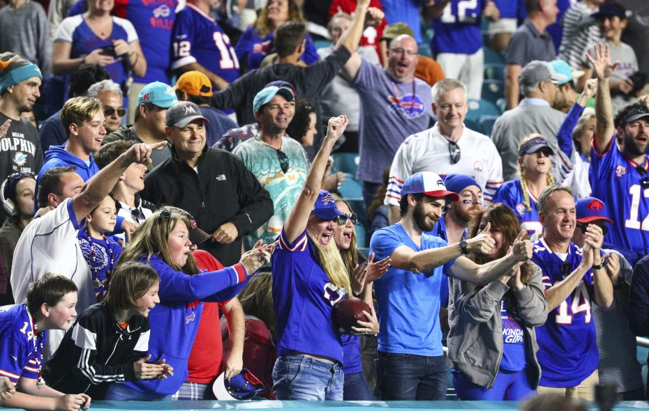 A Bills fan celebrates after she is given a ball by a Bills player during the fourth quarter Hard Rock Stadium in Miami Gardens, Florida on Sunday, Dec. 31, 2017.  (James P. McCoy / Buffalo News)