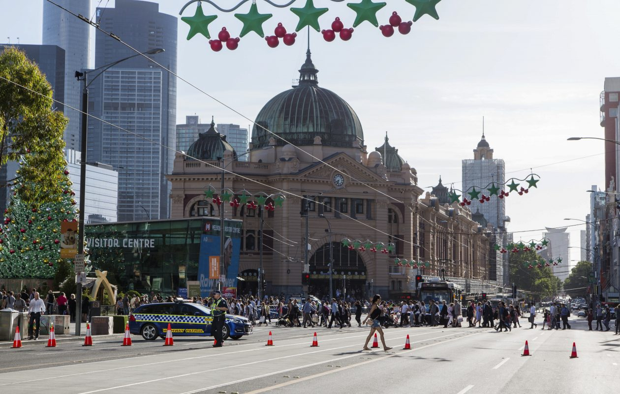 "Police block off Flinders Street after a vehicle rammed into a crowd on the corner of Elizabeth and Flinders Streets in Melbourne, Australia, Dec. 21, 2017. The driver of the SUV who plowed into a crowd on the busy street on Thursday, injuring at least 19 people, was mentally ill, Australian officials said, describing the attack as a deliberate ""act of evil"" but not terrorism. (Asanka Brendon Ratnayake/New York Times)"