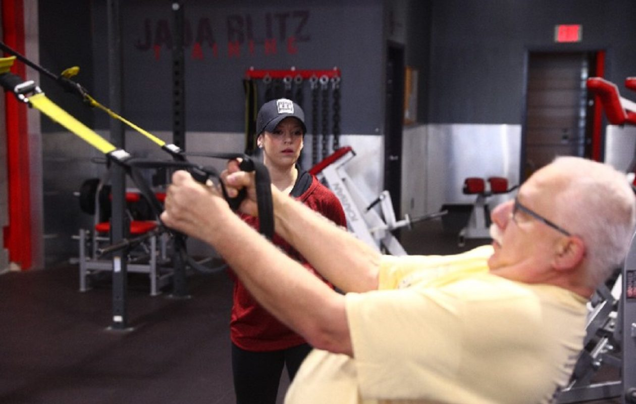 If you're not seeing results from more exercise and a closer watch on your diet, there are several ways you may be slipping up, says Jada Blitz Training personal trainer Aubree Shofner, working with Dan Badaszewski, of Amherst. (Photos by John Hickey/Buffalo News)