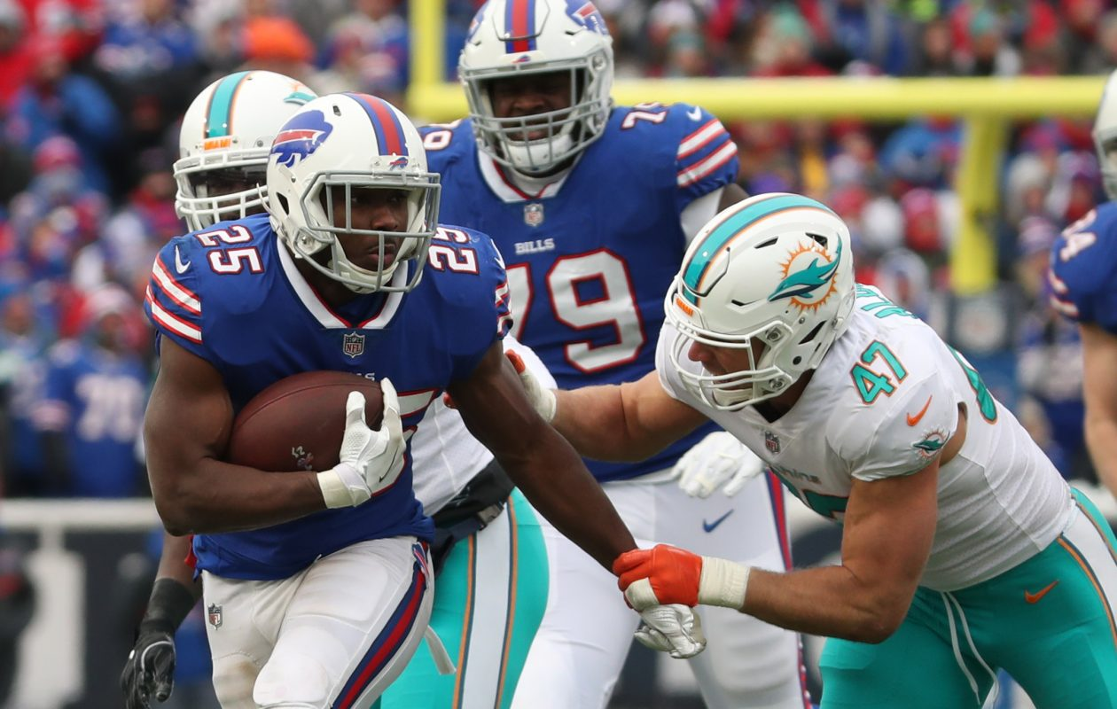 Jordan Mills (79) held off Miami's best edge rusher, Cameron Wake, in one-on-one pass protection virtually the whole game.  (James P. McCoy/Buffalo News)