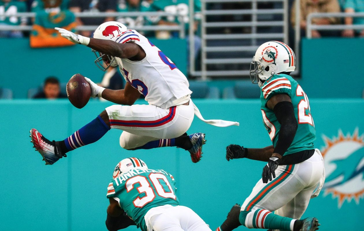 LeSean McCoy leaps over a would-be Dolphins tackler (James P. McCoy/Buffalo News)