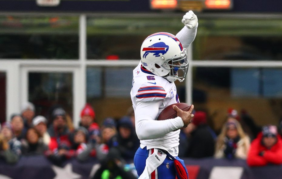 Tyrod Taylor is sacked by Patriots linebacker Marquis Flowers. (James P. McCoy/Buffalo News)