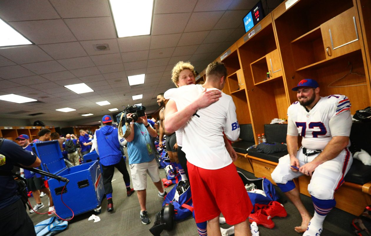 Bills center Eric Wood gets a hug as the team celebrates its trip to the postseason. (James P. McCoy / Buffalo News)