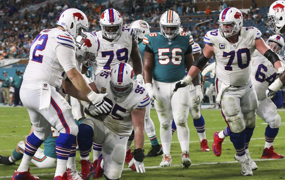 Buffalo Bills defensive tackle Kyle Williams (95) is greeted by teammates after catching a touchdown pass in the third quarter at Hard Rock Stadium in Miami Gardens, Florida on Sunday, Dec. 31, 2017.  (James P. McCoy / Buffalo News)
