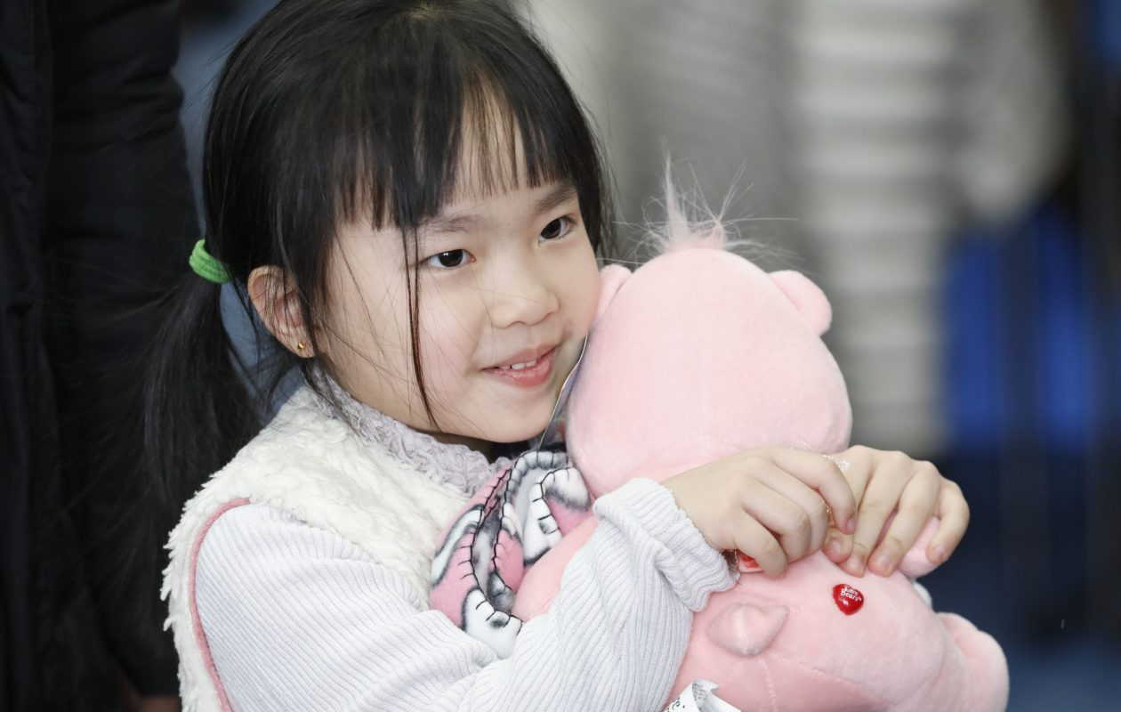 Jessica Dong, 5, hugs the Teddy bear she picked out during the delivery of the Boxes of Love at the Belle Center in Buffalo on Saturday, Dec. 9, 2017.  The Rev. Eric Johns, pastor at the Buffalo Dream Center, organized the Christmas campaign with a goal of giving food and toys to 3,000 families.  The campaign continues next week with distributions scheduled in Buffalo and Niagara Falls.   (Derek Gee/Buffalo News)