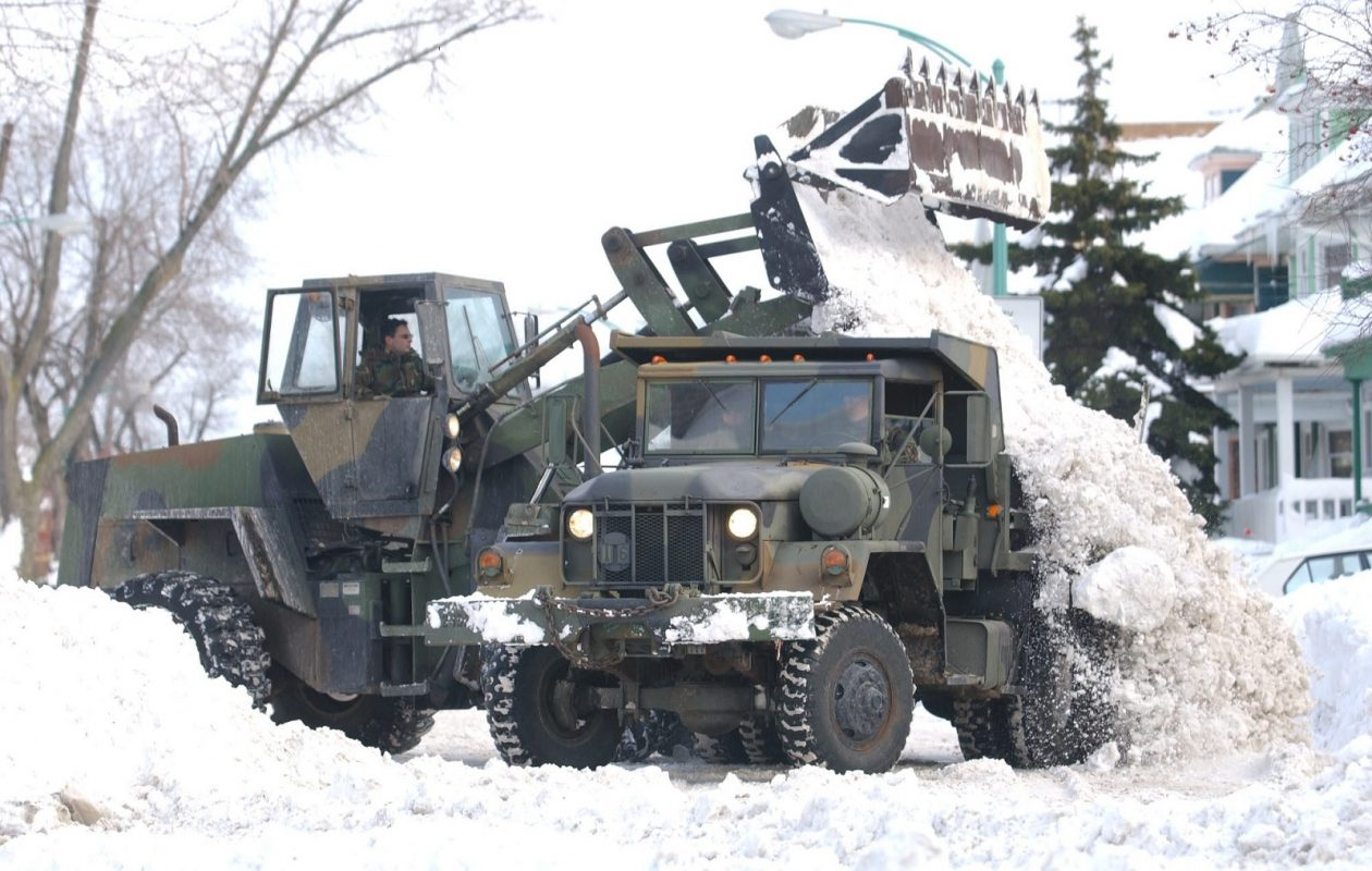 The National Guard uses heavy equipment to clear nearly seven feet of snow on East Delevan Ave. in Buffalo on Dec. 31, 2001 following the previous week's record snowfall. (Sharon Cantillon/Buffalo News)