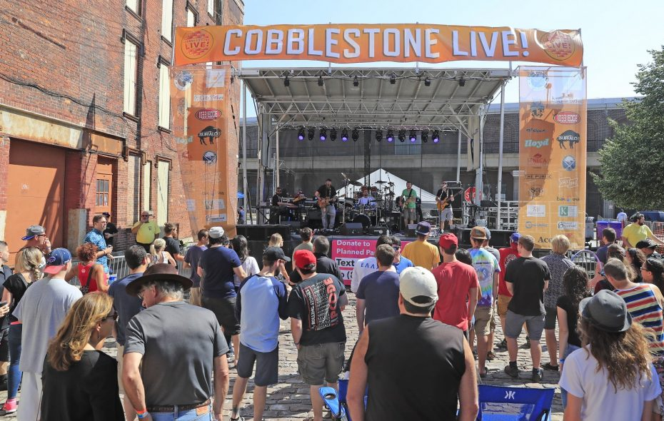 Music fans watch the action on the main stage at the first Cobblestone Live in 2017. (Harry Scull Jr./Buffalo News file photo)