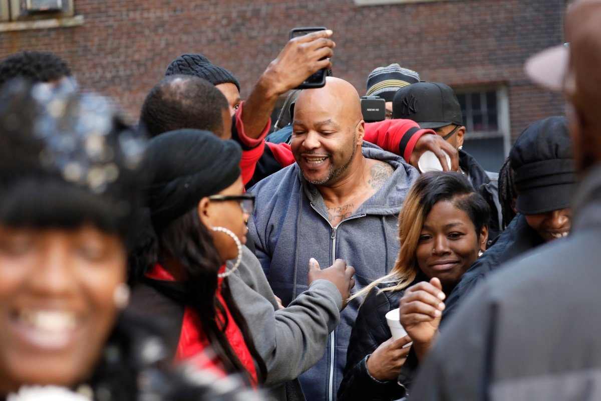 Cory Epps, who spent almost 20 years in prison for a murder he didn't commit, is mobbed by family as he is released from custody after his conviction was vacated in light of new evidence. (Derek Gee/Buffalo News)