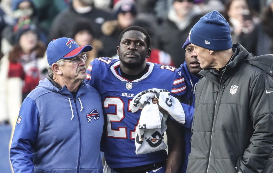 Buffalo Bills cornerback Tre'Davious White leaves the field with help from trainers after New England Patriots tight end Rob Gronkowski hit him late after he intercepted the ball in the fourth quarter at New Era Field. (James P. McCoy/Buffalo News)