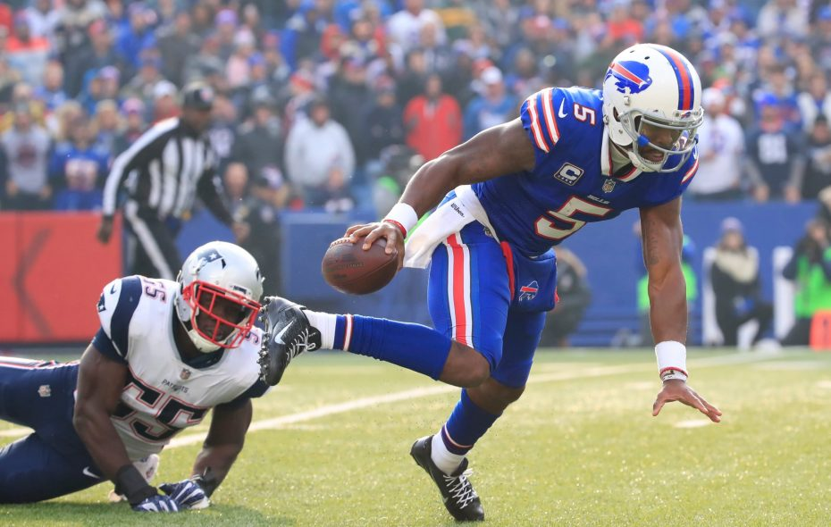 Buffalo Bills quarterback Tyrod Taylor gets tripped up by New England Patriots' Eric Lee. (Harry Scull Jr./Buffalo News)