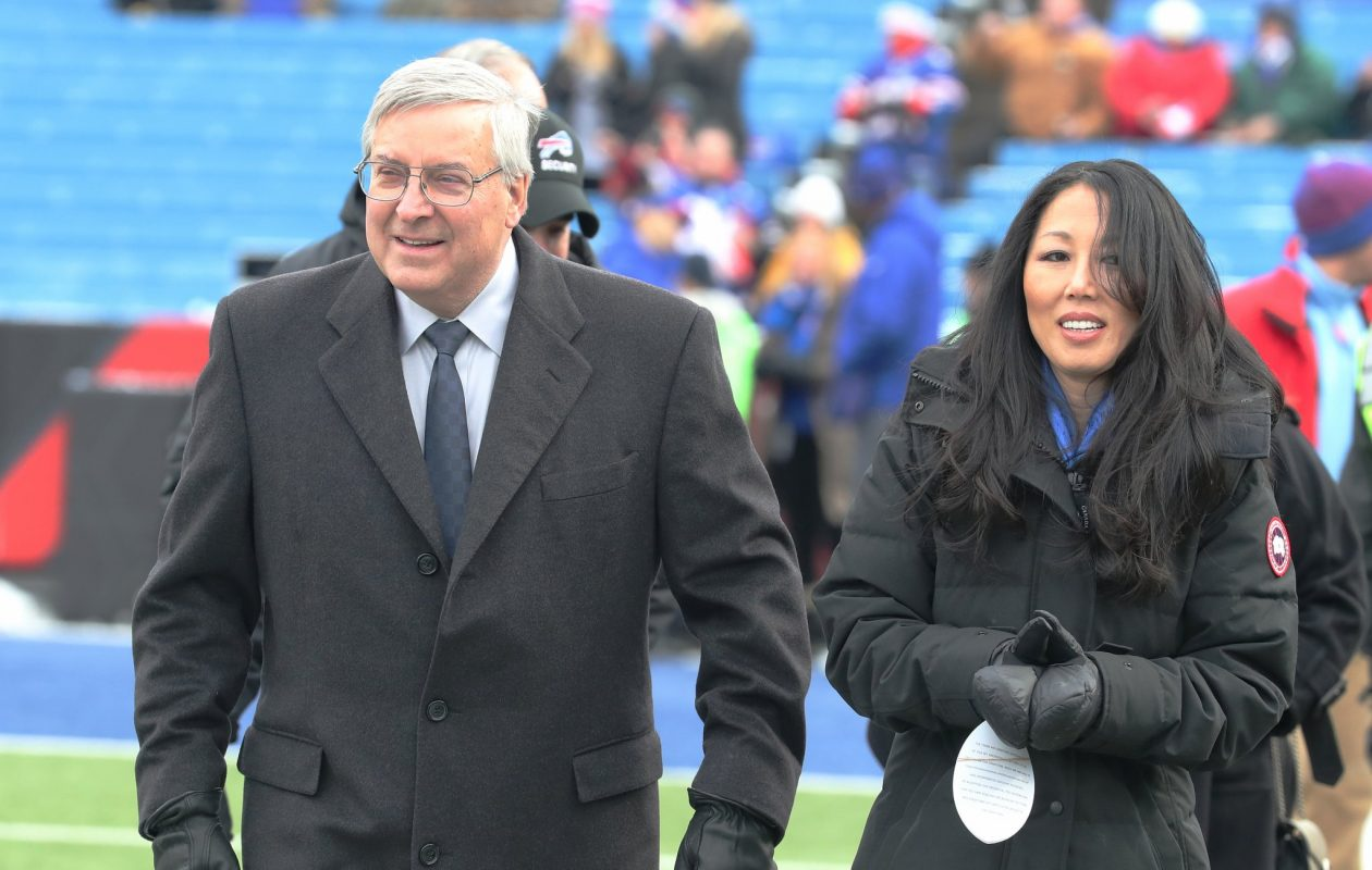 Buffalo Bills owners Kim and Terry Pegula walk the sidelines during pregame at New Era Field on Sunday, Dec. 17, 2017.  (James P. McCoy/Buffalo News)