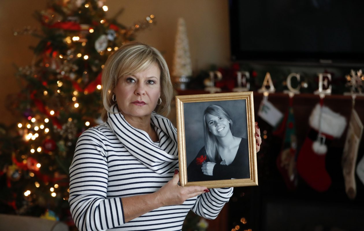 Cheektowaga Town Supervisor Diane Benczkowski holds a picture of her daughter, Kelly, who committed suicide in March 2017. (Mark Mulville/Buffalo News)