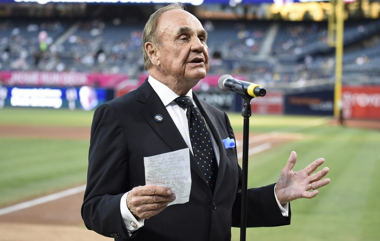 Commentator Dick Enberg, pictured before calling his final home game for the San Diego Padres, died this week. (Denis Poroy/Getty Images)