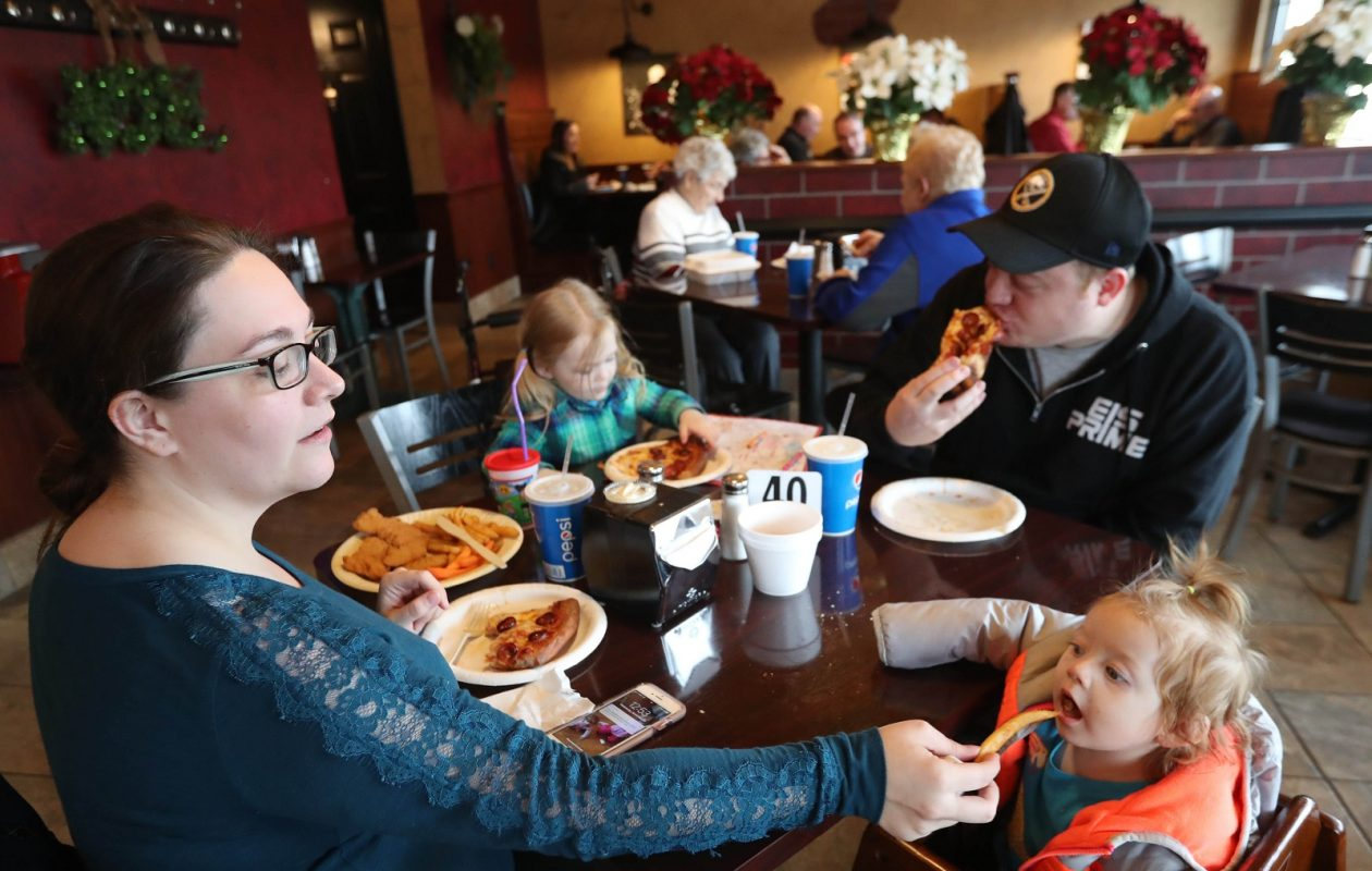 The Bova family of Lackawanna has lunch.  Clockwise, from left, are Mandy, daughter Aria, 2, Nick and daughter Zoe, 1. (Sharon Cantillon/Buffalo News)