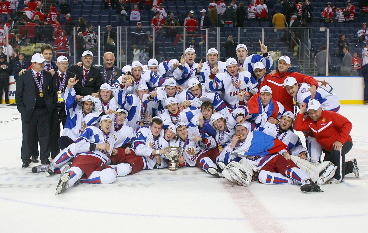 Members of Team Russia pose with the IIHF World Junior Championship trophy after defeating Canada 5-3 (Rick Stewart/Getty Images)