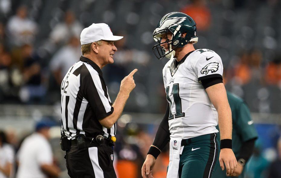 Referee Jeff Triplette talks with Philadelphia Eagles quarterback Carson Wentz. (Getty Images)