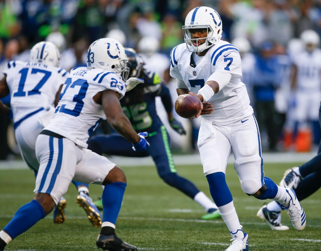 Jacoby Brissett #7 of the Indianapolis Colts hands off the ball to running back Frank Gore #23 the second quarter of the game at CenturyLink Field on October 1, 2017 in Seattle, Washington. (Getty Images)