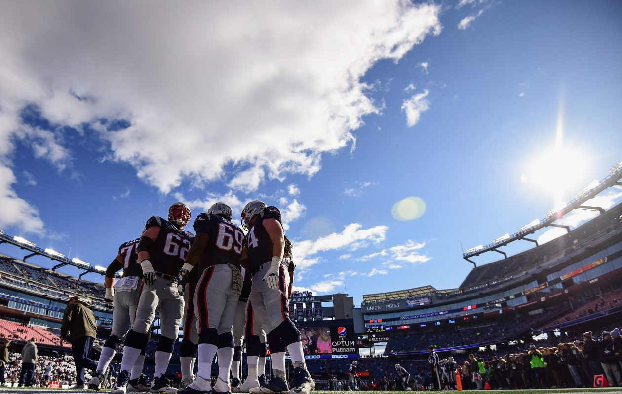 Members of the New England Patriots huddle before a game at Gillette Stadium. (Getty Images)
