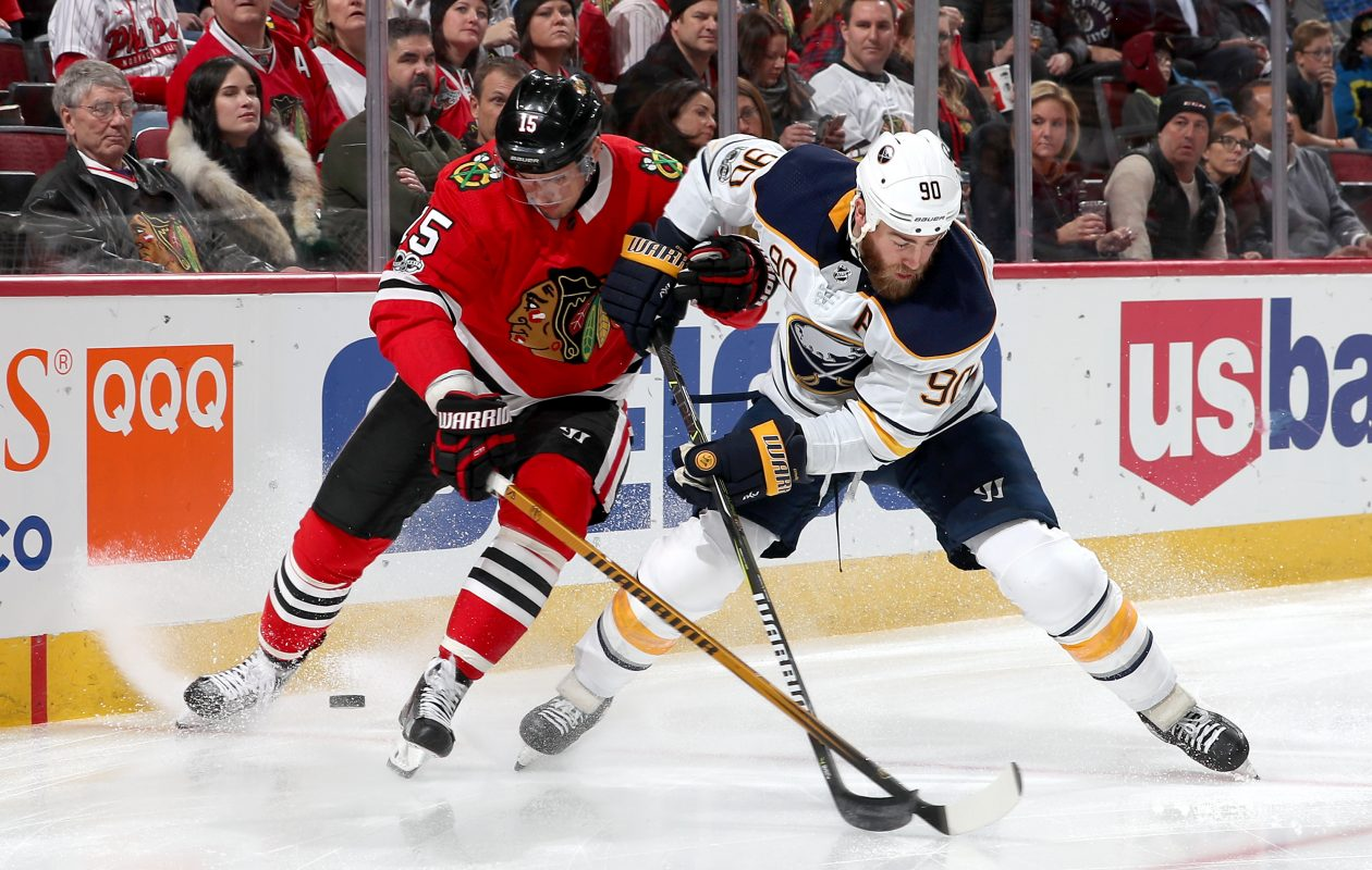 Ryan O'Reilly battles for the puck with Chicago's Artem Anisimov in the first period Friday at United Center (Getty Images).