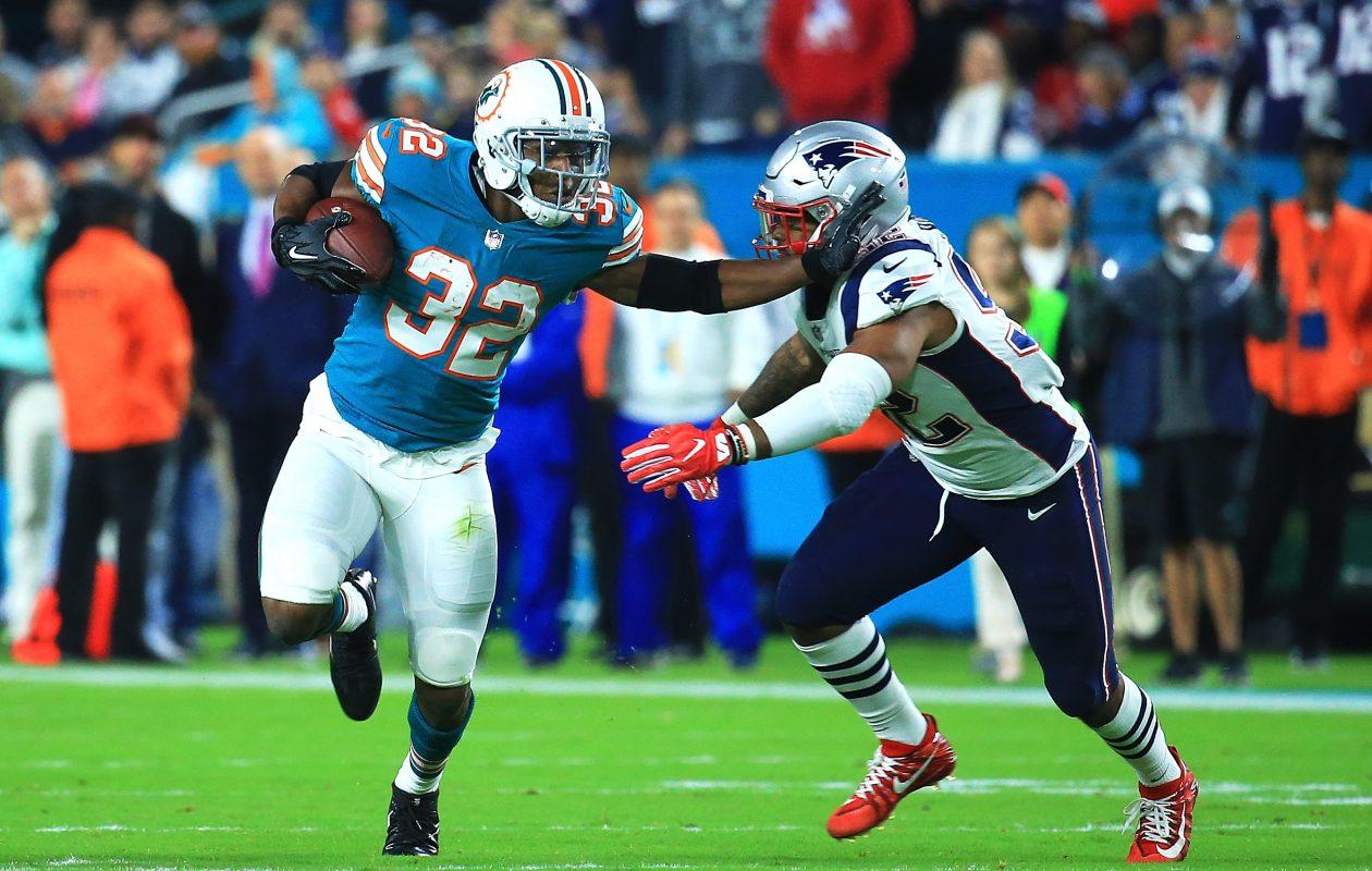 Miami running back Kenyan Drake made New England look bad Monday night. (Chris Trotman/Getty Images)