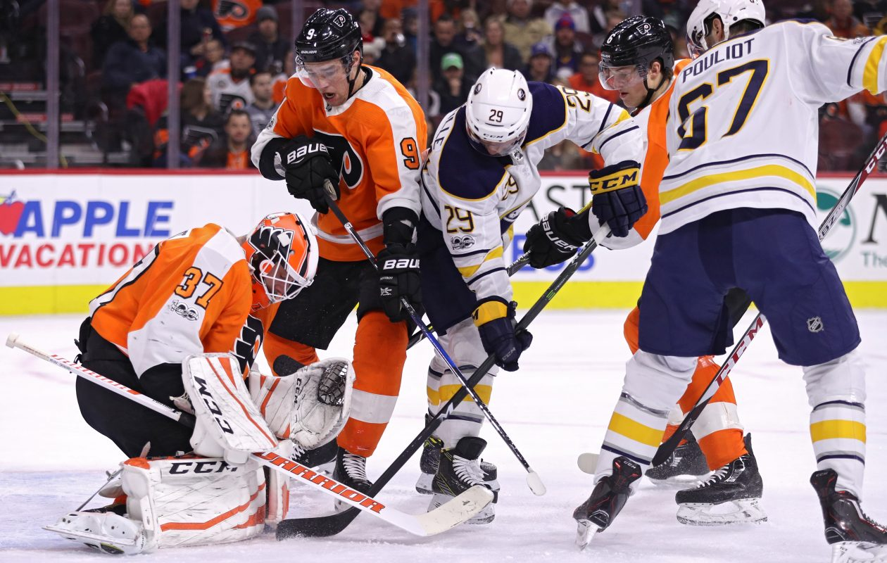 Flyers goalie Brian Elliott makes a save on the Sabres' Jason Pominville. (Getty Images)