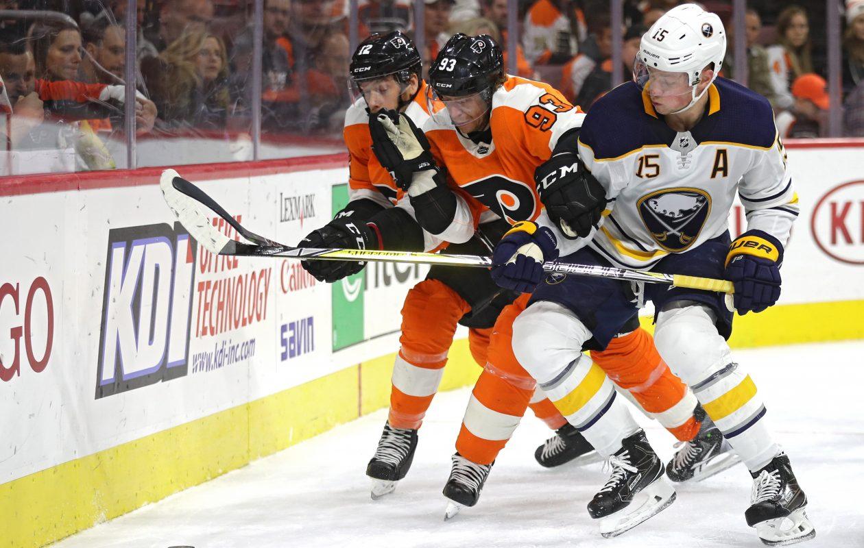 Jack Eichel and Jakub Voracek battle for the puck. (Getty Images)