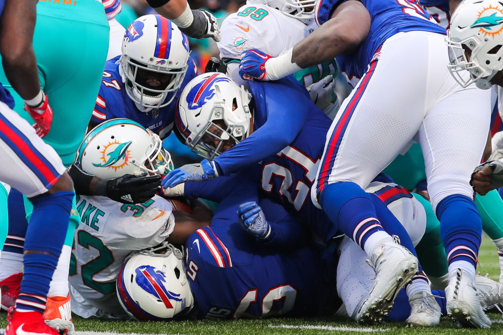 Miami's Kenyan Drake gets tackled by a host of Bills (Getty Images)