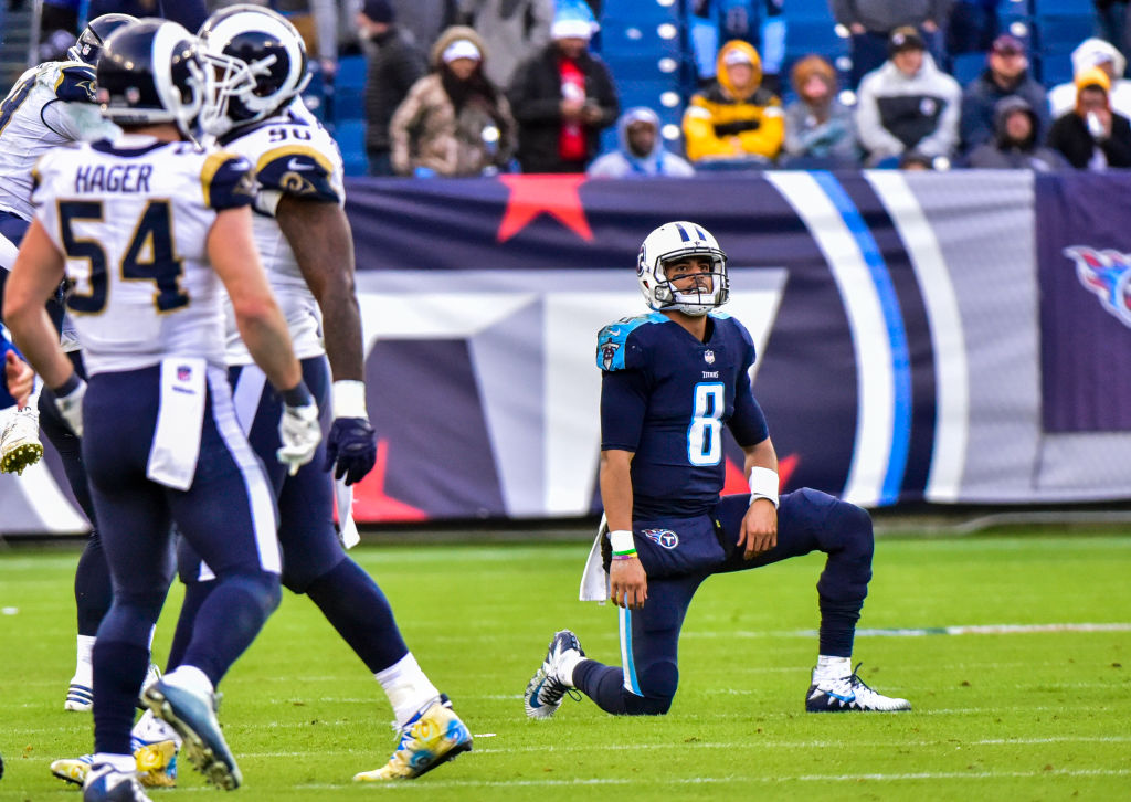 Quarterback Marcus Mariota of the Tennessee Titans reacts after being sacked in the final seconds of the fourth quarter against the Los Angeles Rams. (Getty Images)