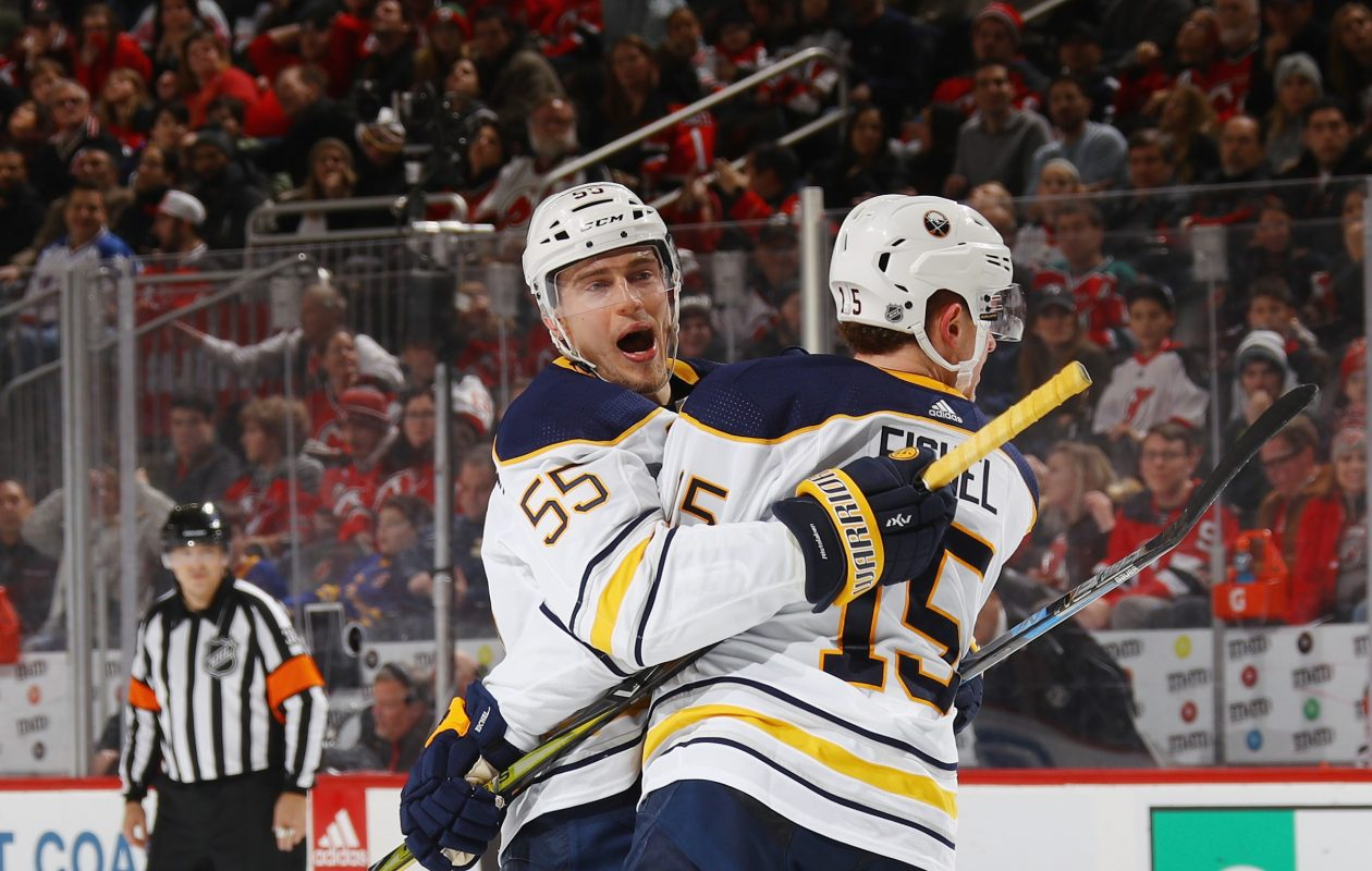 Rasmus Ristolainen (55) and Jack Eichel had plenty to celebrate Friday. (Getty Images)