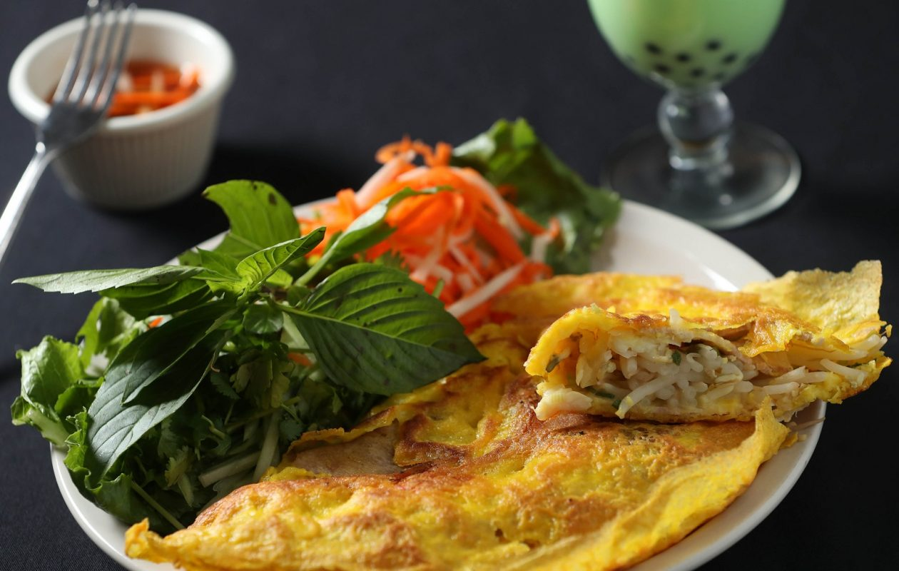 Pho Golden's banh xeo appetizer is a Vietnamese pancake with sliced pork and shrimp served with fish sauce. (Sharon Cantillon/Buffalo News)