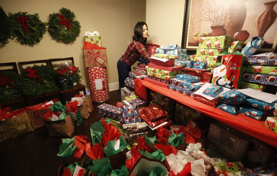 S.E.R.V. Niagara founder Jennifer D'Andrea gets ready to distribute gifts in Lockport Tuesday, December 19, 2017.   (Mark Mulville/Buffalo News)